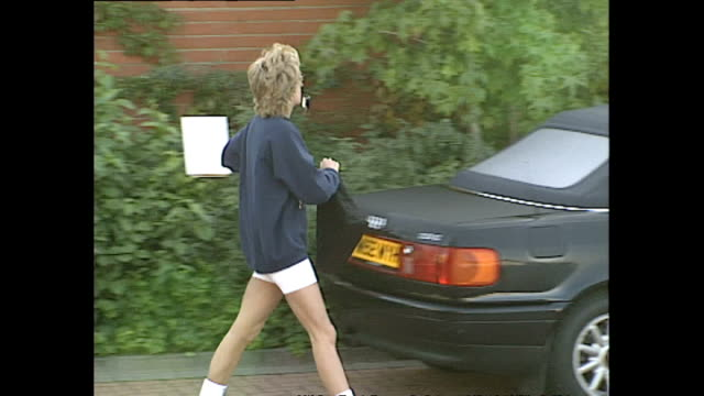 exterior shots of princess diana wearing gym clothes leaving a health club and getting into her audi convertible car and driving off, persued by... - paparazzi photographer stock videos & royalty-free footage