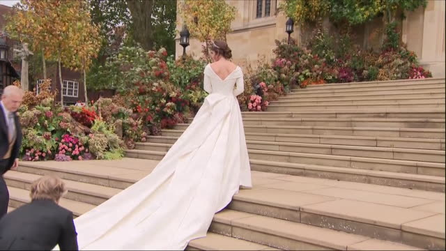 exterior shots of princess eugenie arriving in flowing wedding gown designed by peter pilotto and christper de vos at st george's chapel on her... - prinzessin stock-videos und b-roll-filmmaterial