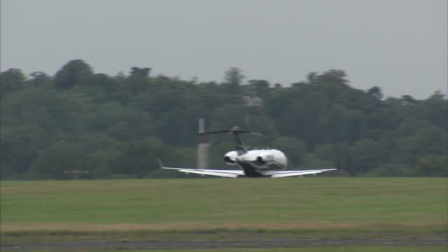 exterior shots of private jets and a helicopter taking off & landing at biggin hill airfield on august 18, 2015 in kent, london. - biggin hill stock videos & royalty-free footage