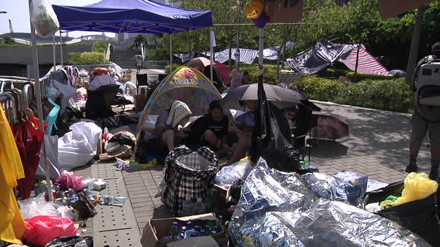 exterior shots of pro democracy protesters in their tents sleeping bags as commuters travel to work on october 6 2014 in hong kong china - occupy central stock videos & royalty-free footage