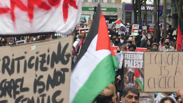 GBR: UK: Pro Palestine protests continue as Police in London have made four arrests after a group of people waving Palestinian flags drove though parts of London shouting violent anti-semitic threats.
