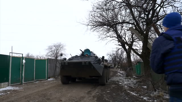 exterior shots of pro russian rebels in an armoured personnel carrier driving past on february 19, 2015 in debaltseve, ukraine. - ceasefire stock videos & royalty-free footage