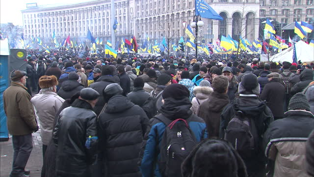 exterior shots of proeurope protesters signing the ukrainian national anthem and listening to speakers during demonstrations in independence square... - ukraine stock videos & royalty-free footage