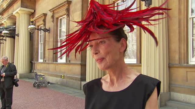 exterior shots of professor katharine hamnett wearing interview on being awarded the obe for services to fashion katharine is wearing a striking red... - katharine hamnett stock videos & royalty-free footage