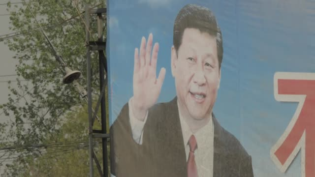 exterior shots of propaganda posters depicting chinese president xi jinping in hebei province on 12 april 2019, peoples republic of china. - poster stock-videos und b-roll-filmmaterial