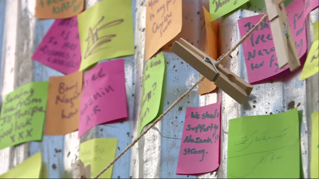 exterior shots of protest messages of support for richard ratcliffe as he goes on hungerstrike outside the iranian embassy protesting his wife's... - richard ratcliffe video stock e b–roll