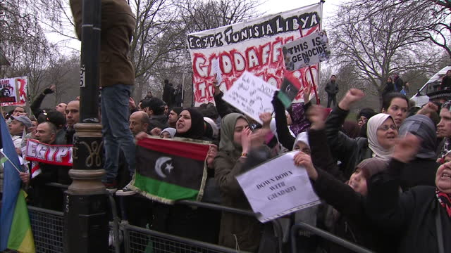 exterior shots of protesters chanting and shouting outside libyan embassy in london whilst waving banners and placards libyan embassy protests in... - arab spring stock videos & royalty-free footage