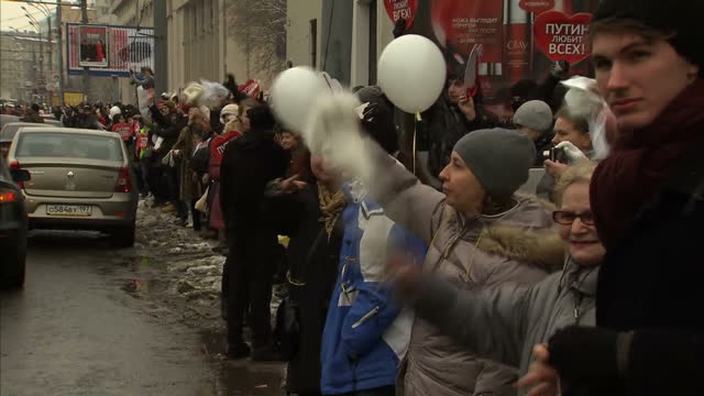 exterior shots of protesters forming a human chain in protest at vladimir putin in moscow protesters form human chain against putin on february 26... - vladimir russia stock videos and b-roll footage