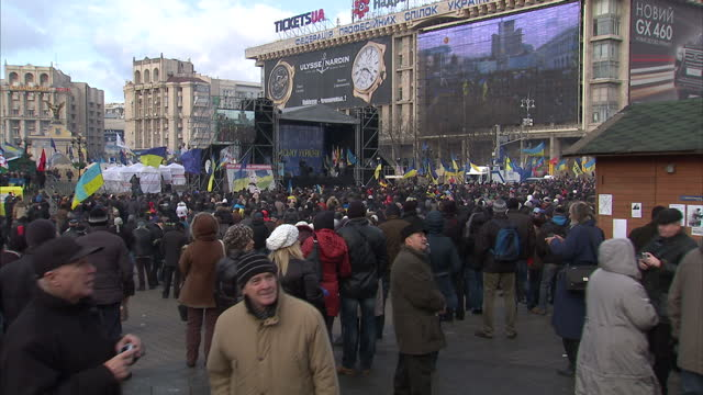 Exterior shots of protesters gathered in Independence Square Kiev protesting against Viktor Yanukovych's government Anti Russia rally in centre of...