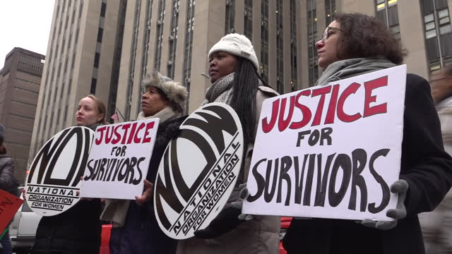 """exterior shots of protesters holding signs """"justice for survivors"""" on 7 january 2020 in new york, united states. - social movement stock videos & royalty-free footage"""