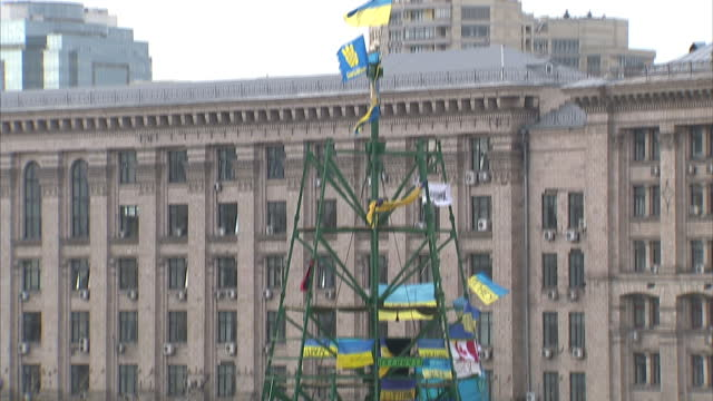 Exterior shots of protesters in Independence Square Kiev banging oil drums gathered for mass anti government rally Anti government rally in...