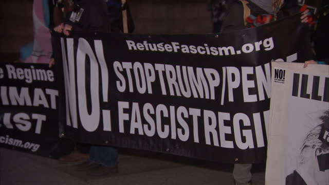 Exterior shots of protesters outside the White House with banners and chanting 'No peace no justice' against the Keystone XL pipeline proposals on...