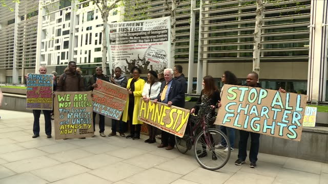 exterior shots of protesters with banners and placards outside the home office demonstrating against the treatment of immigrants on 1 may 2018 in... - deportation stock videos & royalty-free footage