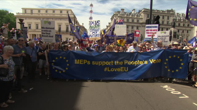 exterior shots of protestors on march for a people's vote including placards, banners and a large flag with mep's support the people's vote on 23... - mep stock videos & royalty-free footage