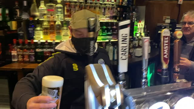 exterior shots of pub drinkers waiting to be served as outdoor hospitality re-opens, and interior shots of bar staff pulling pints of lager on 12... - indoors stock videos & royalty-free footage
