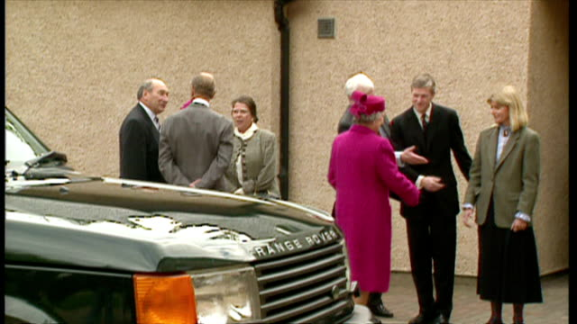 exterior shots of queen elizabeth and prince philip arriving at gordonstoun school and greeting their grandchildren peter phillips and zara phillips.... - peerage title stock videos & royalty-free footage