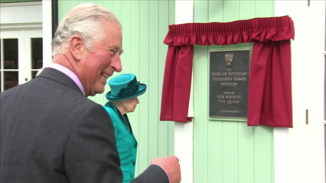 exterior shots of queen elizabeth ii and charles prince of wales duke of cornwall arriiving at new highland games pavillion with the queen unveilling... - plaques stock videos & royalty-free footage