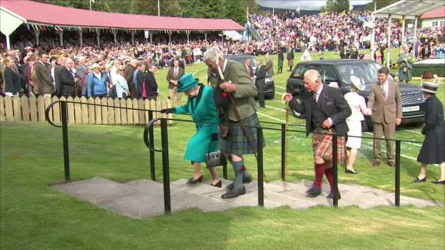exterior shots of queen elizabeth ii and charles prince of wales duke of cornwall arriving followed by anne princess royal and her husband sir... - highland games stock videos & royalty-free footage