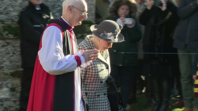 exterior shots of queen elizabeth ii and prince andrew the duke of york depart from st mary the virgin church and walk back to their waiting car on... - church stock videos & royalty-free footage