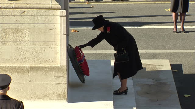 exterior shots of queen elizabeth ii and prince philip, duke of edinburgh laying poppy wreaths at the cenotaph during the annual remembrance sunday... - remembrance sunday stock videos & royalty-free footage