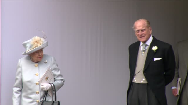 exterior shots of queen elizabeth ii and prince philip duke of edinburgh exiting st george's chapel after the wedding of their granddaughter princes... - prince philip stock videos & royalty-free footage