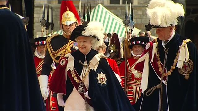 exterior shots of queen elizabeth ii and prince philip, duke of edinburgh attending the order of the garter service with the rest of the royal... - windsor england stock videos & royalty-free footage