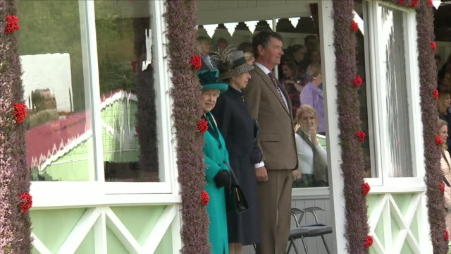 exterior shots of queen elizabeth ii charles prince of wales duke of cornwall anne princess royal and her husband sir timothy laurence listening to... - highland games stock videos & royalty-free footage