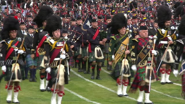 exterior shots of queen elizabeth ii , charles, prince of wales, duke of cornwall , anne, princess royal and her husband sir timothy laurence being... - bagpipes stock videos & royalty-free footage