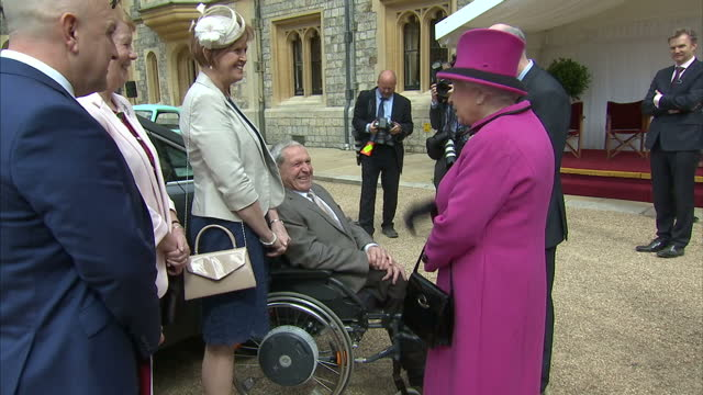 exterior shots of queen elizabeth ii meeting a family who lease a wheelchair accessible vehicle through the motability charity during a ceremony to... - lease agreement stock videos and b-roll footage