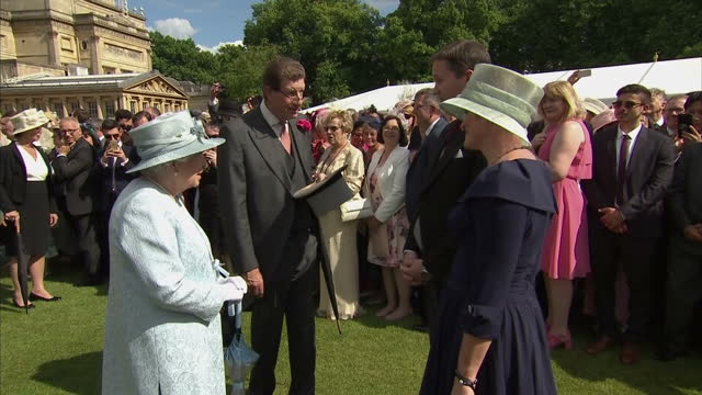 Exterior shots of Queen Elizabeth II meeting guests at a garden party in the grounds of Buckingham Palace on 1st June 2017 London England