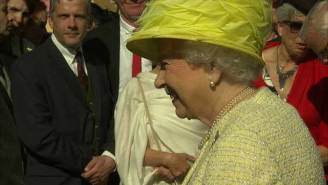 exterior shots of queen elizabeth ii meeting guests at royal garden party at buckingham palace on may 12, 2015 in london, england. - toothy smile stock videos & royalty-free footage