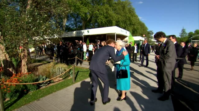 exterior shots of queen elizabeth ii meeting prince harry with shots of prince harry giving her a kiss on both cheeks before introducing her to... - chelsea flower show stock videos & royalty-free footage