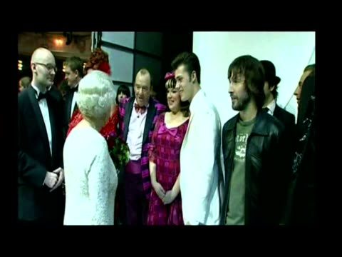 exterior shots of queen elizabeth ii & prince philip arriving and greeted by people. interior shots of the queen meeting and shaking hands with... - mel smith stock-videos und b-roll-filmmaterial