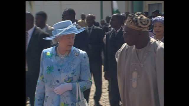 Exterior shots of Queen Elizabeth II Prince Philip Duke of Edinburgh escorted by Nigerian President Olusegun Obasanjo as they depart Abuja airport at...