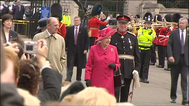 exterior shots of queen elizabeth ii receiving flowers from crowds and prince philip, duke of edinburgh chatting to the crowds during a visit to... - british royalty stock videos & royalty-free footage