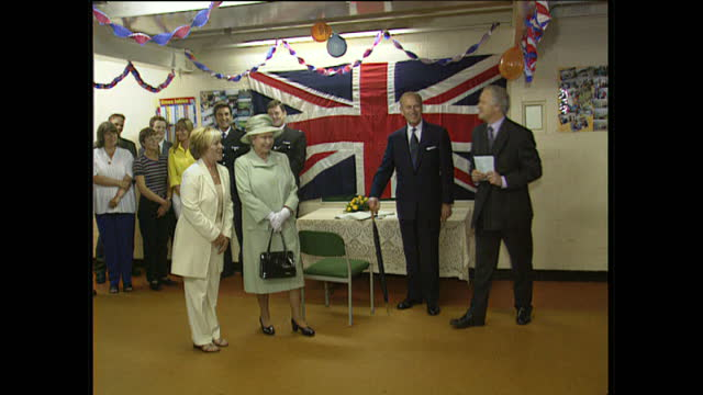 exterior shots of queen elizabeth ii visiting residents at st andrews gardens and the central library on july 22, 1999 in liverpool, england. - duke of edinburgh stock videos & royalty-free footage