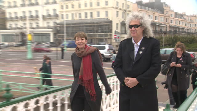 exterior shots of queen singer brian may walking onto a bandstand with the green party's caroline lucas on april 13 2015 in brighton england - bandstand stock videos and b-roll footage