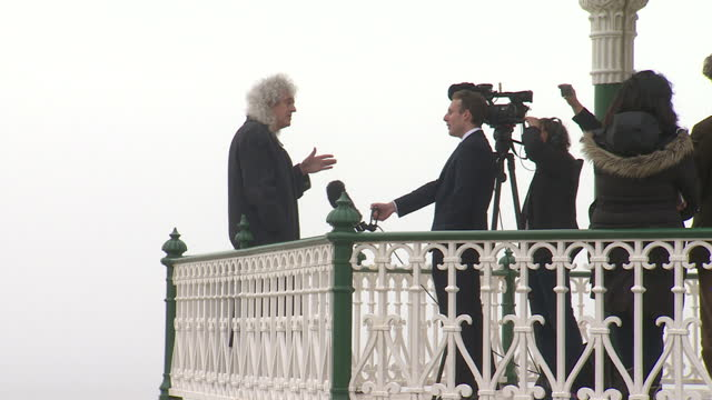 Exterior shots of Queen's Brian May being interviewed on the end of a bandstand on Brighton seafront on April 13 2015 in Brighton England