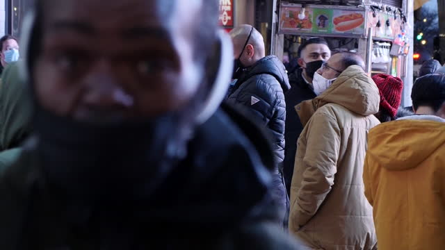 exterior shots of quiet manhattan streets with many people in face masks around times square on new year's eve on 31 december 2020 in new york,... - new york stock videos & royalty-free footage