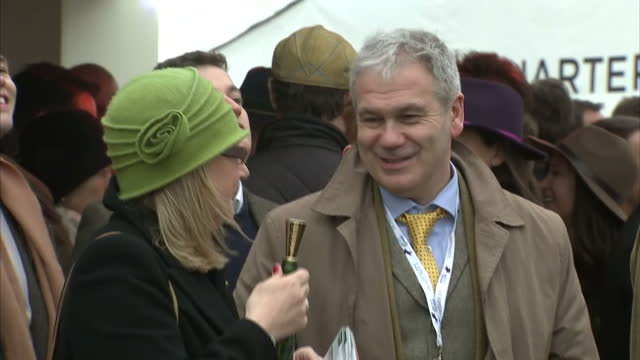 exterior shots of race goers at the cheltenham festival drinking moet champagne during the cheltenham gold cup on 17 march 2017 in cheltenham united... - cheltenham stock videos & royalty-free footage
