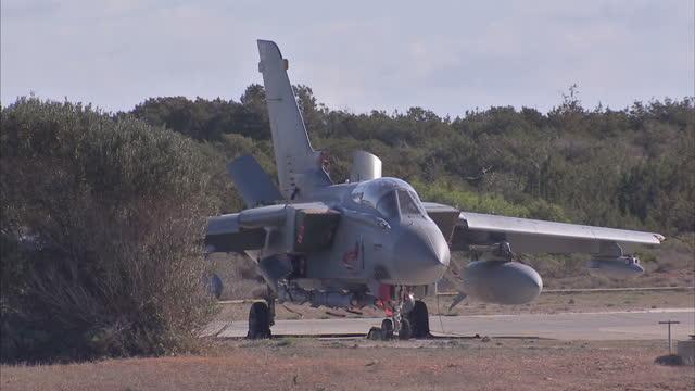 exterior shots of raf tornado gr4 fighter jets on the hangar at raf akrotiri airbase on december 05 2015 in akrotiri cyprus - royal air force stock-videos und b-roll-filmmaterial