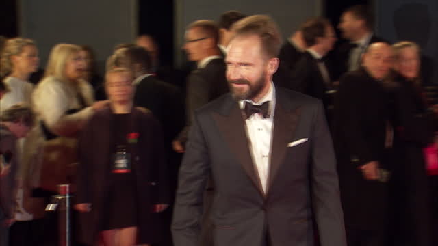 exterior shots of ralph fiennes attending the royal film performance of 'spectre' at the royal albert hall on october 26 2015 in london england - spectre 2015 film stock videos and b-roll footage