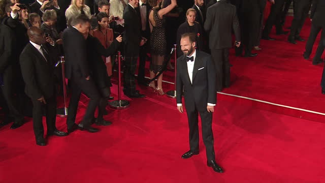 exterior shots of ralph fiennes attending the royal film performance of 'spectre' at the royal albert hall on october 26, 2015 in london, england. - レイフ・ファインズ点の映像素材/bロール