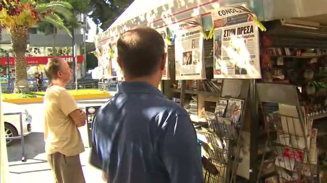 exterior shots of reading newspapers outside a street seller newspaper stand on july 20 2015 in athens greece - 緊急援助点の映像素材/bロール