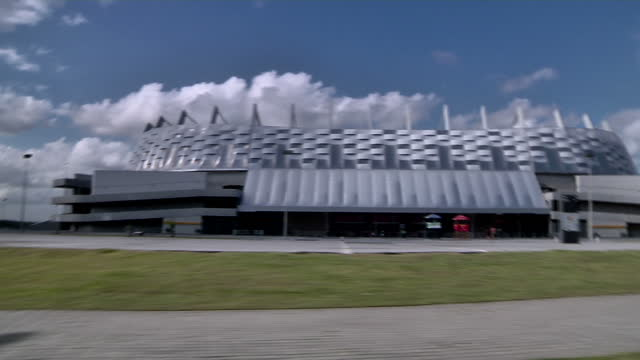 exterior shots of recife's arena pernambuco stadium shot from a moving car ahead of brazil's 2014 world cup - recife stock videos and b-roll footage