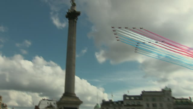 exterior shots of red arrows aerial display team performing fly past over london's trafalgar square to mark 80th anniversary of charles de gaulle's... - square stock videos & royalty-free footage
