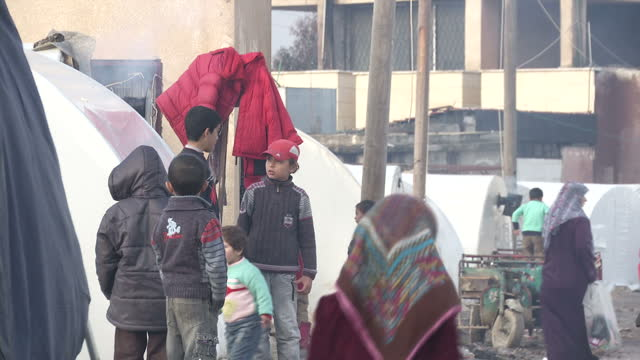 exterior shots of refugees at a refugee camp in a'zaz including many children>> on february 05 2013 in unspecified syria - シリア難民問題点の映像素材/bロール