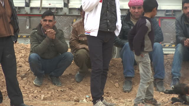 exterior shots of refugees from raqqa gathered at the side of a road, including families with young children.>> on december 13, 2015 in unspecified,... - 2015 stock videos & royalty-free footage
