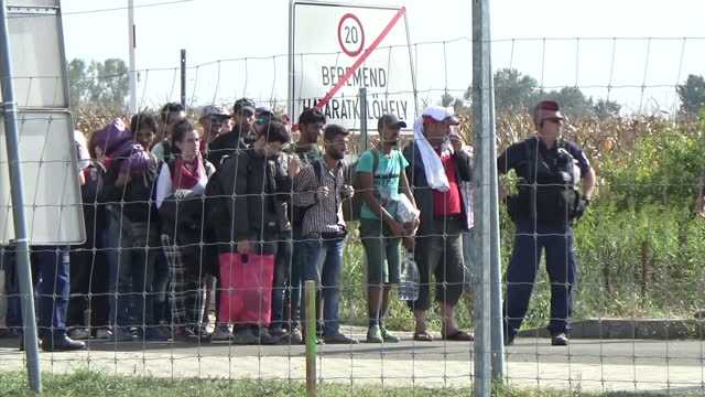 Exterior shots of refugees on the Croatian Hungarian border and a group of soldiers stood by on September 19 2015 in Tovarnik Croatia