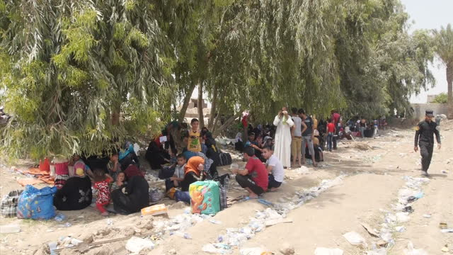 Exterior shots of refugees resting in the shade after travelling on May 21 2015 in Anbar Iraq
